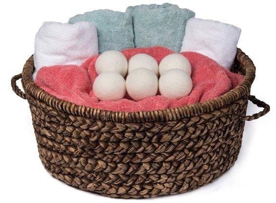 Wool dryer balls in laundry basket