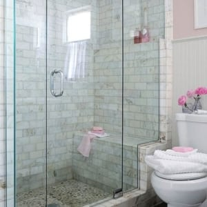 A close up of pink tub and shower