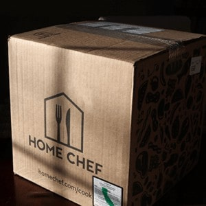 Home Chef delivery box filled with meal kit sitting on