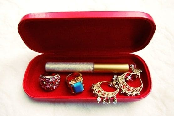 Glasses case holding jewelry