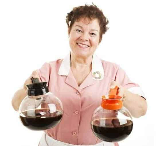 A person posing for the camera, with Coffee Carafe