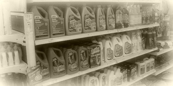 Store shelf of caustic drain cleaning chemicals