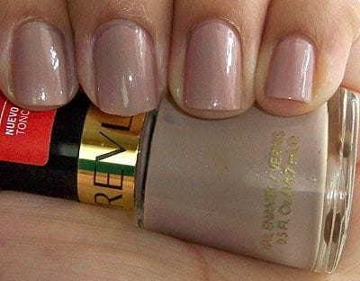 Fingers holding nail polish