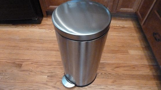Trash can with trash bag in the kitchen