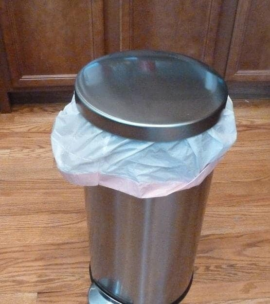 Trash can on kitchen floor