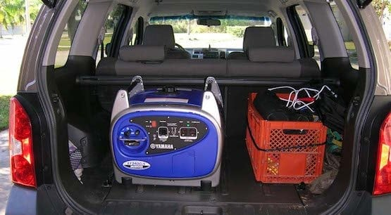 Portable generator in back of car