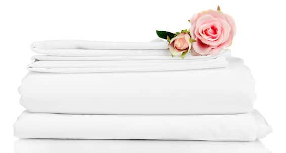 White bed sheets with flowers
