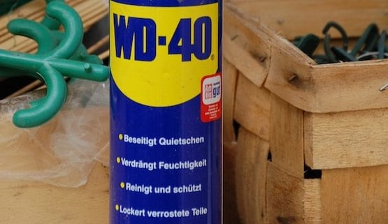 A can-of-WD-40-sitting-in-the-garage-with-wooden-crates