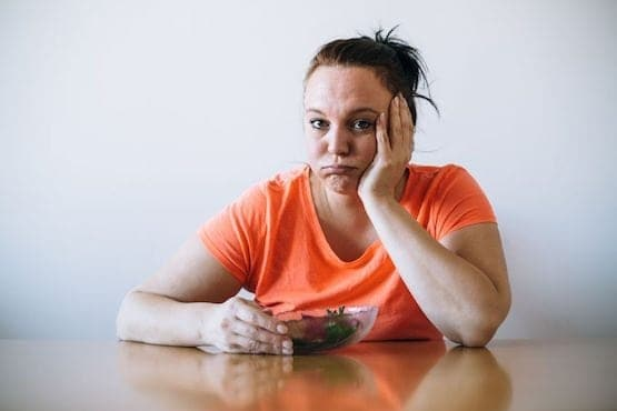 37348136 - unhappy overweight woman on diet