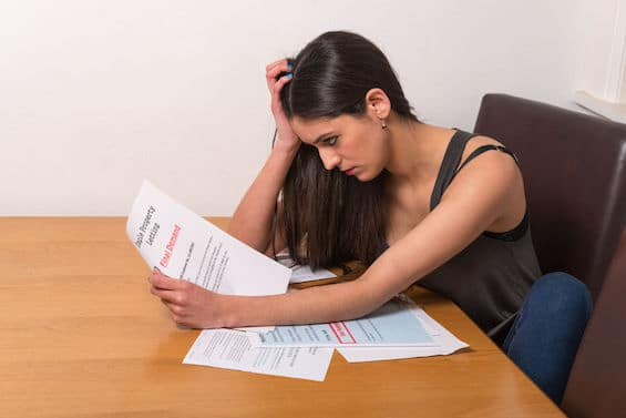 Recent graduate stressed confused worried by student loan debt