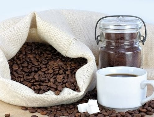A cup of coffee, with Coffee bean