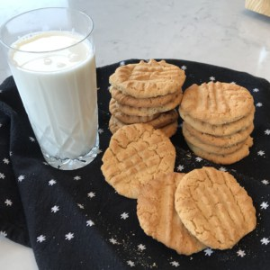 homemade peanut butter cookies with glass of cold milk