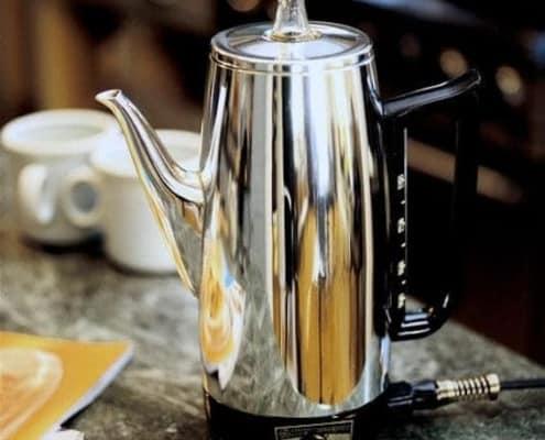 percolator coffee pot sitting on table