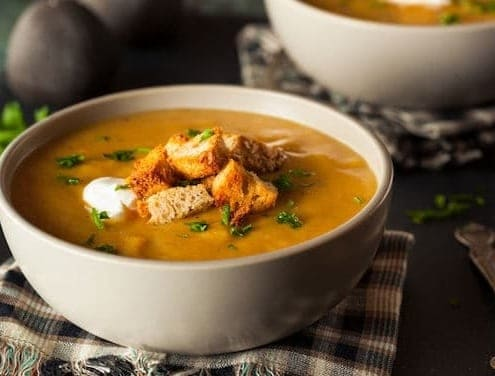 Pumpkin soup in a bowl with croutons