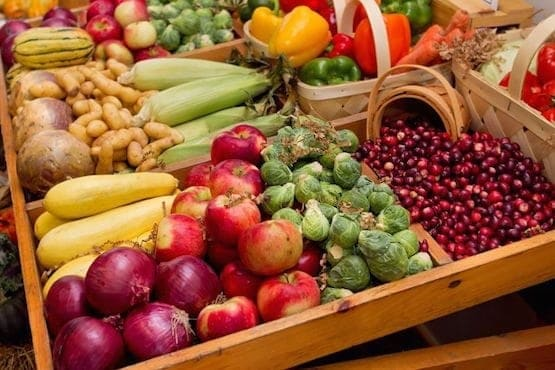 A box filled with fresh fruit and vegetables on display