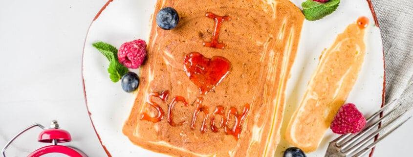 Back to school kids breakfast, pancakes with raspberry jam