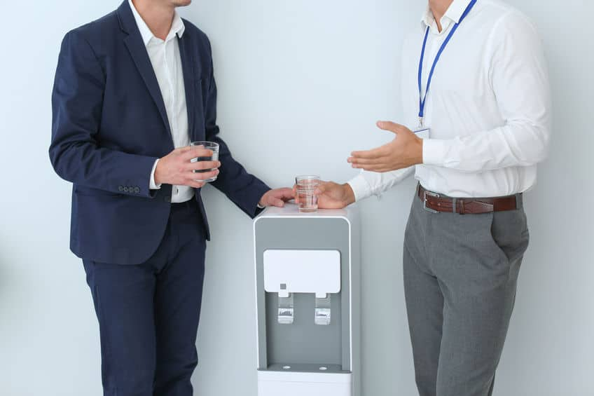 Men having break near watercooler on white background, closeup