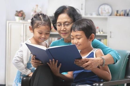 Grandma reading to grandkids