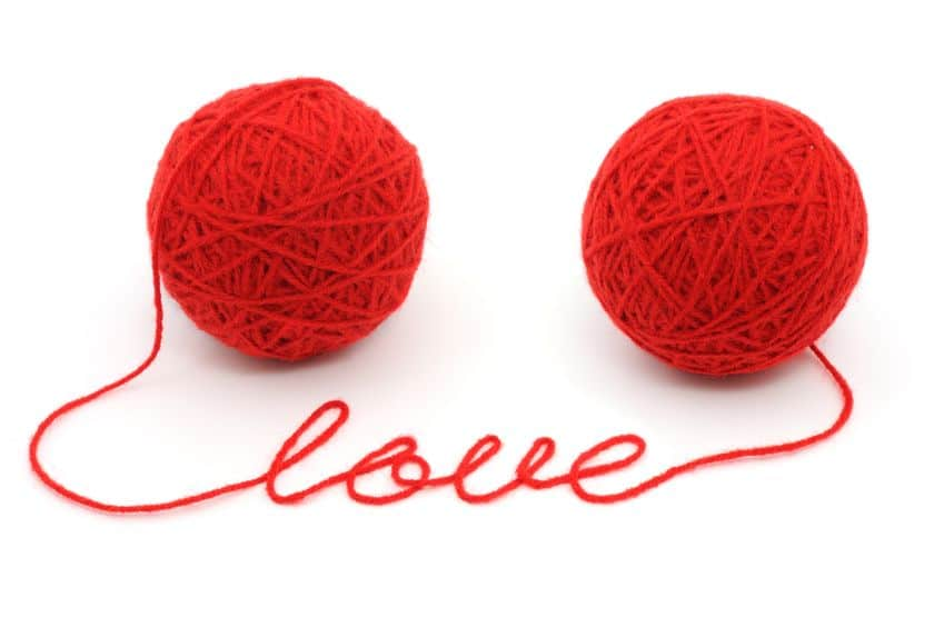 thread balls with word 'love' isolated on white background