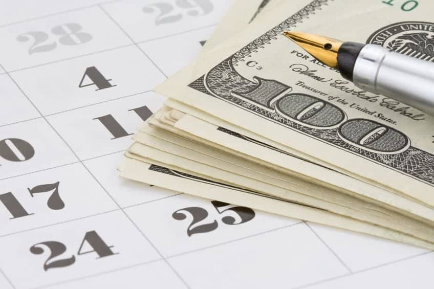 Pen and money on calender
