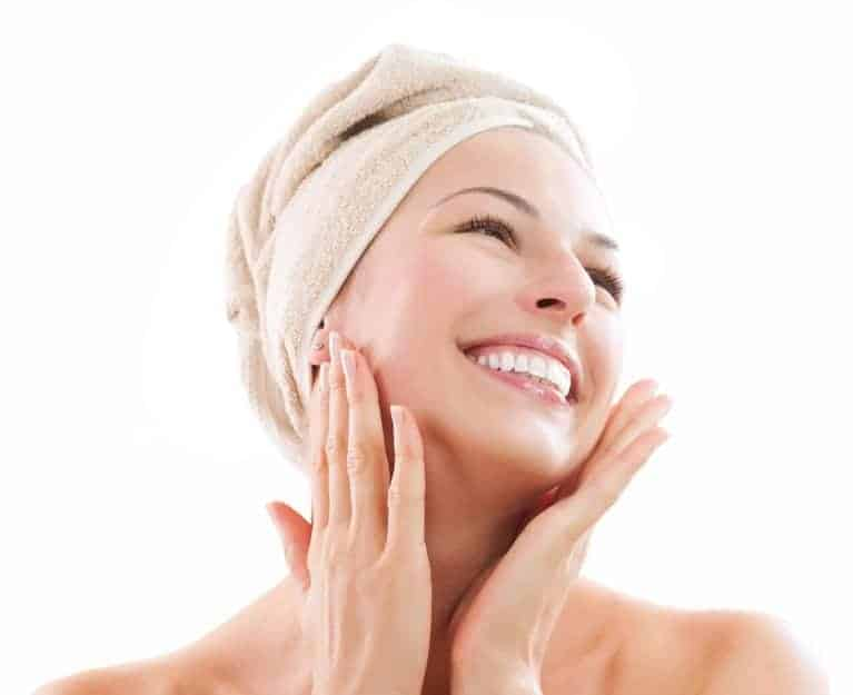 14873611 - beautiful girl after bath touching her face skincare