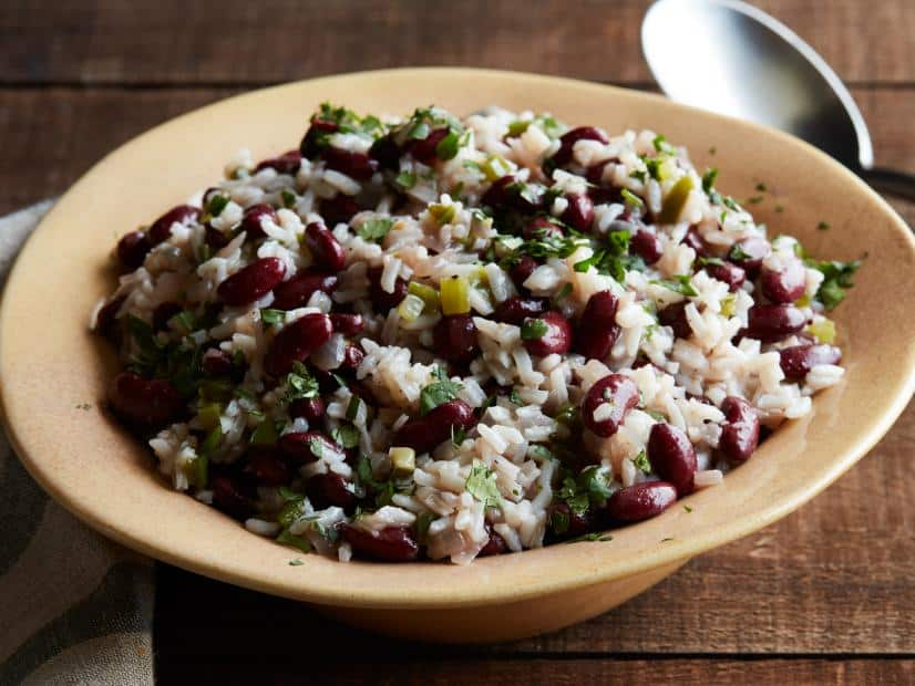 A bowl of food on a plate, with Bean and Rice