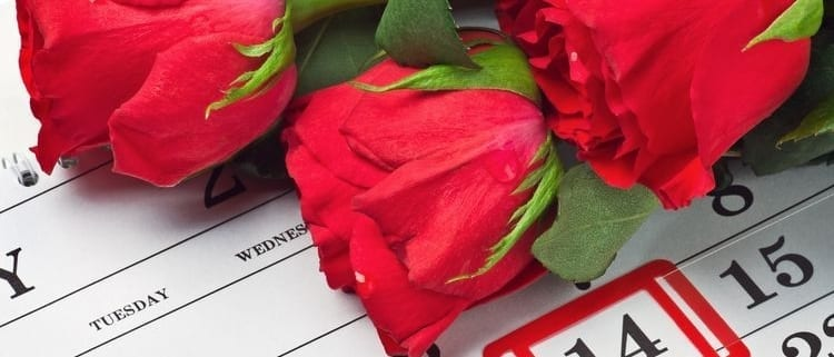 Red-roses-on-Calendar-with-Date February-14-Valentine's-Day