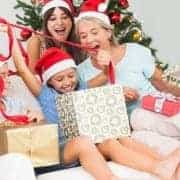 happy-family-at-christmas-opening-gifts-together-on-the-couch