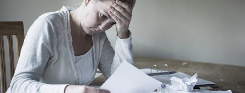 woman-with-debt-worried-about-bills-to-pay