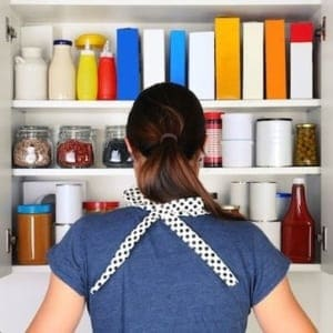 Woman checking to make sure she has 9 essential pantry items on hand