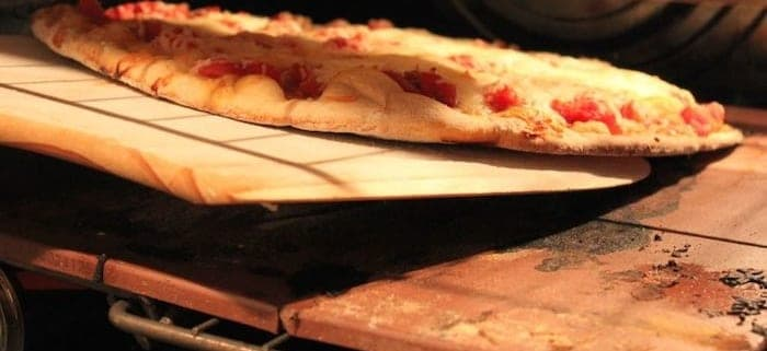 A pizza sitting on top of a stove
