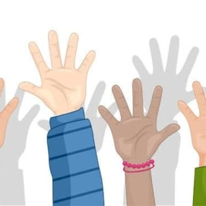Multi ethnic hands up in the air waiting to ask a question