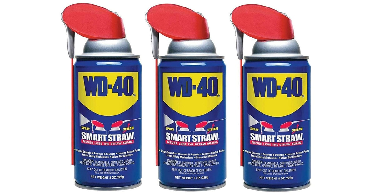 3 cans WD-40 on white background