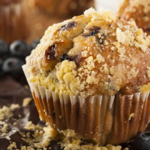 homemade blueberry muffin on wood board