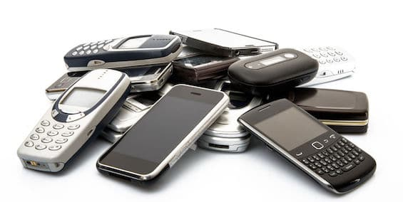 Old and Obsolete Cellphones on white background