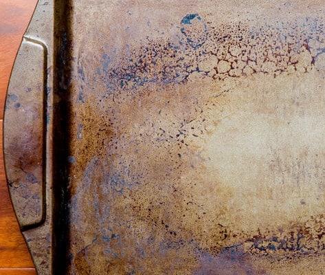 A close up of a dirty pan