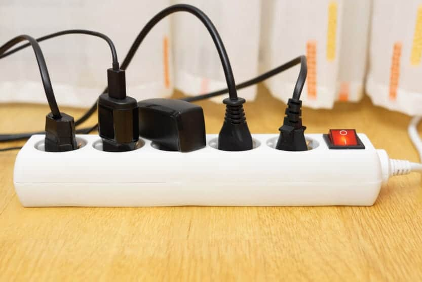 Household power strip with each outlet being used to power an electrical device