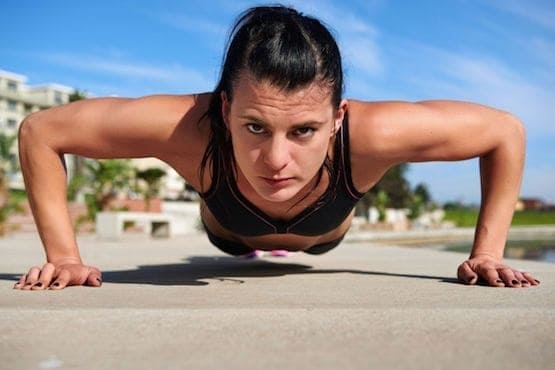 young fit woman doing pushups