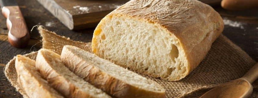 a cut-loaf-warm-crusty-homemade-bread