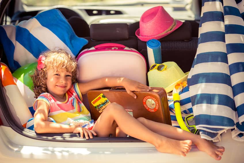 Child going on summer vacation. Car travel and beach concept