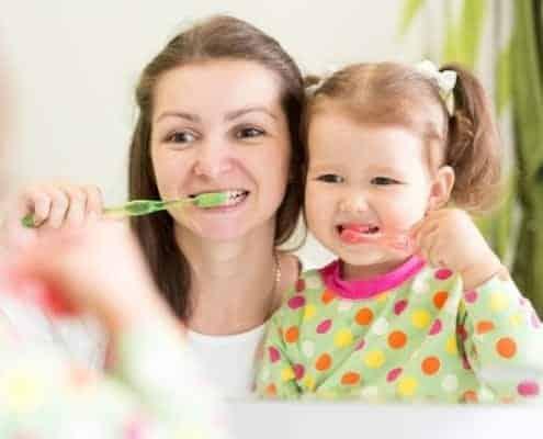 A little girl brushing her teeth