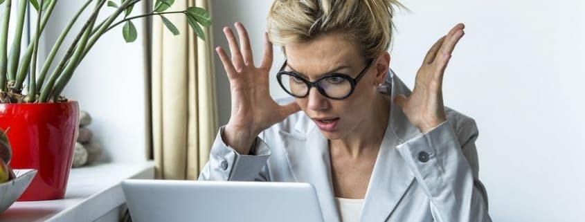Business-woman-in-a-state-of-shock-sitting-near-the-computer