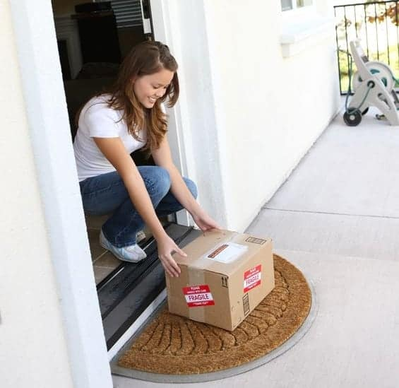 a-pretty-woman-at-home-picking-up-delivery-box