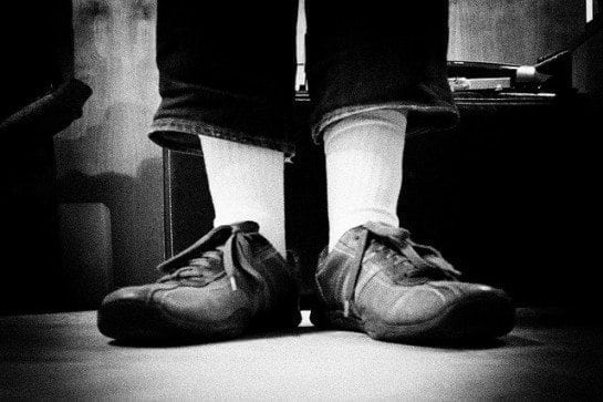 Black and white photo of man in shoes