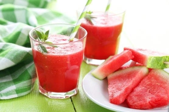 45766907 - fresh watermelon juice in the glass on wooden table
