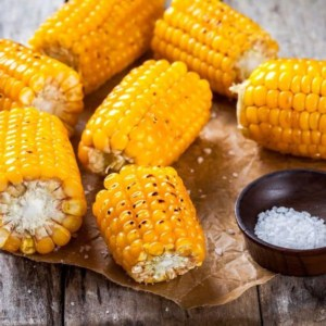 Food on a table, with Corn on the cob and Sweet corn