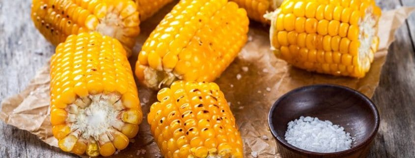 Grilled sweet corn on the cob hot slathered with butter and saal