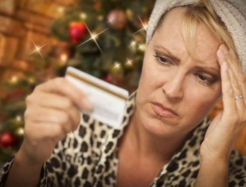 woman upset by Christmas credit-card debt