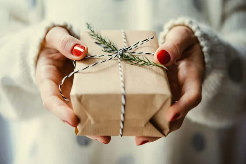 Woman Offering Christmas Gift