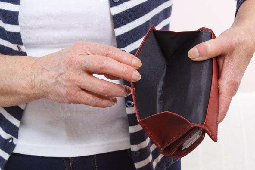 older-woman-empty-wallet-feeling-poor